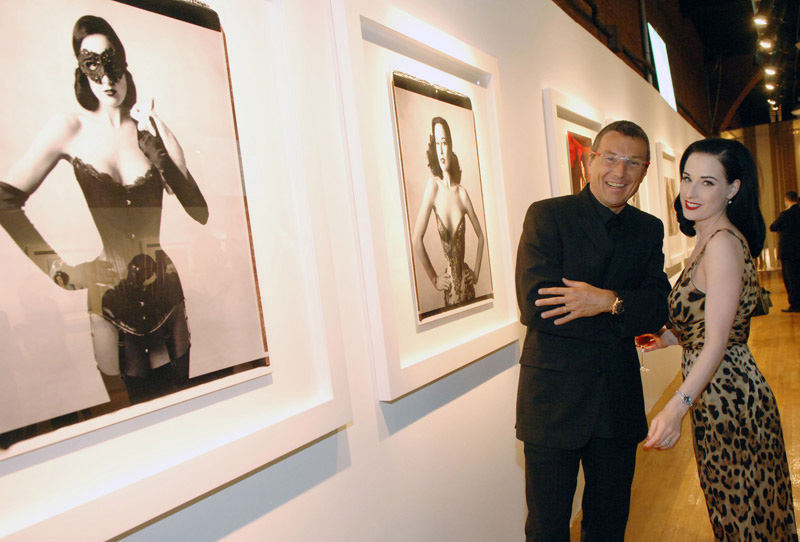 TAG Heuer President and CEO Jean-Christophe Babin & Dita Von Teese at the exhibition gallery.