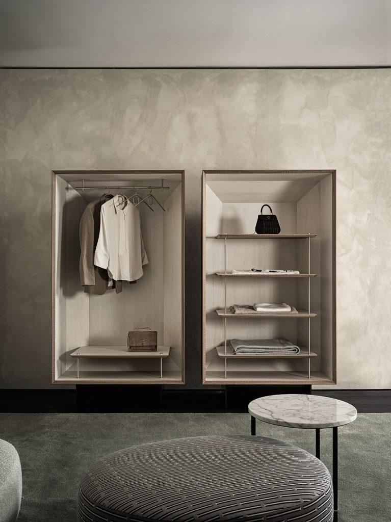 Duale Wardrobe: Duale is a stunning new storage system from luxury Italian brand, Gallotti & Radice. Featuring a beautiful fusion of frise walnut and white Tanganika wood, it is a visually soothing and minimal wardrobe. It's carefully designed rails and shelves ensure fuss-free storage and easy access to your favourite outfits. Meanwhile, the brass details complement the pared back woods, adding a luxe Italian touch. Pictured here with the Audrey Pouf and Cookies Circle Coffee Table - also available at Chaplins.