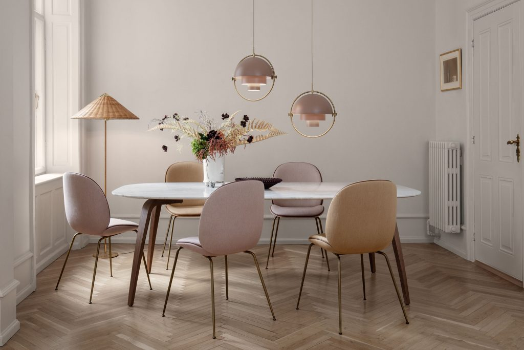 CHAPLINS 9602 Floor Lamp and Beetle Chairs By Gubi. This striking oriental-inspired lamp was originally designed in 1935 for the Hotel Aulanko in Finland. It bears all the hallmarks of Eastern aestheticism, transforming humble materials such as wicker and canvas into a timeless, ethereal luminaire.