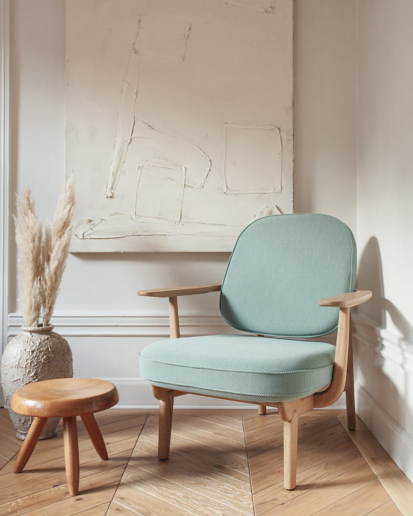 CHAPLINS JH97 Fred Armchair By Fritz Hansen. The JH97 Lounge Chair is a classic Danish design by Fritz Hansen. Its long, elegant frame is inspired by the graceful physiology of a pelican, which wraps around the generous seat and back cushions. The upholstery is available in plush velvet, leather or an on-trend Bouclé fabric. Available to purchase from September 2019, it's definitely one to watch this season.