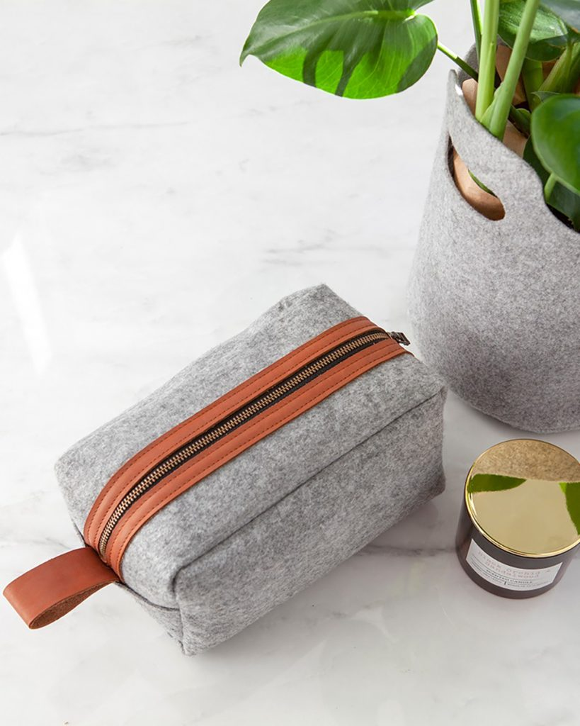 This luxury Washbag is the perfect travel accessory, keeping your toiletries safe and all in one place.  Made from recycled plastic bottle felt fabric with vegetable tanned leather accents. Fully lined with water resistant lining.