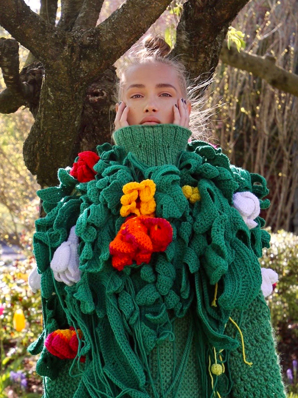 Shades of green oversized hand knit dress embellished w/brightly colored crochet botanical elements by Nataliia Pugach - @visualsbynp, FIT - Fashion Design BFA '20.