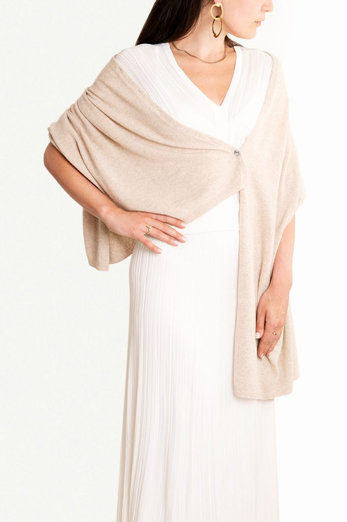 Knüg's luxuriously soft cashmere button wraps are gloriously multi-purpose and can be worn in many ways, including as a shrug, cardigan, poncho, shawl, and scarf.