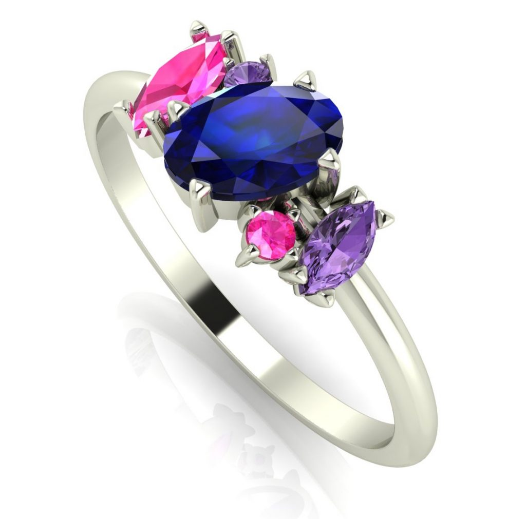 Atlantis - Sapphire Rainbow - Blue. Diverse, exciting and unusual this ring features an 18ct white gold band with stunning sapphires that twist around each other creating the illusion of movement. This ring would make a beautiful, quirky engagement ring or for any special occasion.