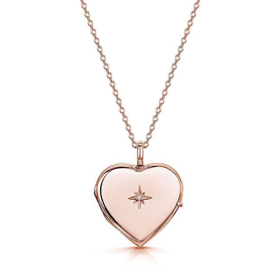 Diamond set solid silver personalized locket with rose gold plate from LOVELOX. Bringing a touch of brilliance to a classic design, this necklace features a real diamond inset into the front case of the locket, leaving a beautiful gold surface on the reverse for a crisp custom engraving. This sizeable but neat piece offers timeless style which deserves to be a staple of any woman's wardrobe.