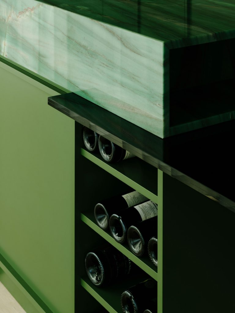 """The cooking island combines the quartzite and the lacquered wood with black-tinted glass, and is covered by a playful and sculptural lighting by PSLab, who provided all of the lights for the apartment. An important detail of the green box is that the ceiling is part of the box and is held away from the concrete ceiling. In this way, the """"box"""" is not just a freestanding object but it makes rooms."""