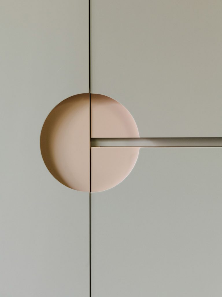 A detail of the bathroom cabinet door handle. Photo ©Robert Rieger, Courtesy of Ester Bruzkus Architekten.